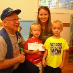 Paul Lodge presents gift certificate to Kaden, Parker & Jessica St. Pierre