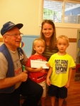 Paul Lodge presents gift certificate to Kaden, Parker & Jessica St. Pierre.jpg