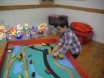 playing with Brio trains.jpg