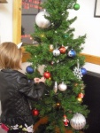 Adding decorations to the children's Christmas tree (1).jpg