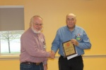 2014 Larry Cannon presents to Tom Coulombe the NMRA, Seacoast Division, Spate Public Service Award 10-18-14.jpg